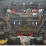 1. Залезьте под днище авто и гаечным ключом открутите винты крепления защиты двигателя