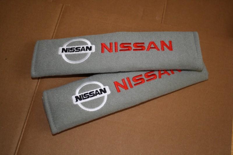 Аксессуар для ремней безопасности с логотипом Ниссан