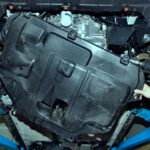 Открутите саморезы и снимите защиту двигателя.