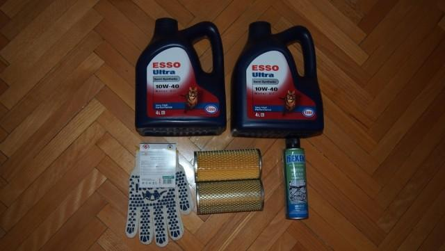 Моторное масло Ессо Ultra 10W-40 в четырехлитровой канистре, перчатки, фильтры и промывочная жидкость