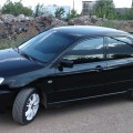 Черный автомобиль Митсубиси Лансер 9