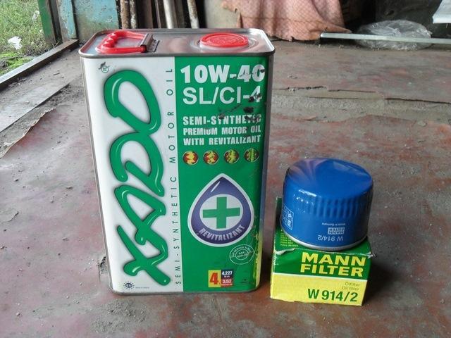 Моторная жидкость Хадо в четырехлитровой канистре и масляный фильтр Mann