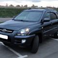 Черный автомобиль Kia Sportage