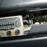 Найдите диагностический разъем в вашем авто, обычно он расположен слева.